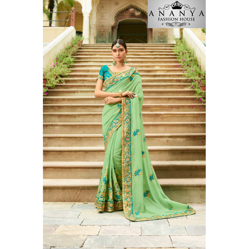 Charming Light Green Georgette Saree with Dark Green Blouse