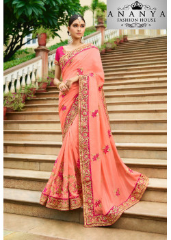 Dazzling Orange Georgette Saree with Pink Blouse