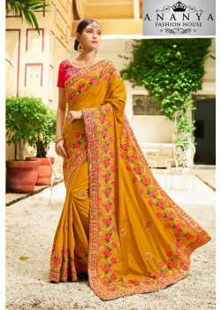 Enigmatic Yellow Georgette Saree with Pink Blouse