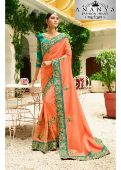 Gorgeous Orange Georgette Saree with Dark Green Blouse