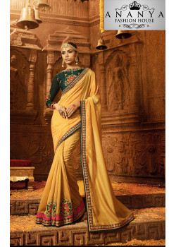 Adorable Yellow Georgette Saree with Dark Green Blouse