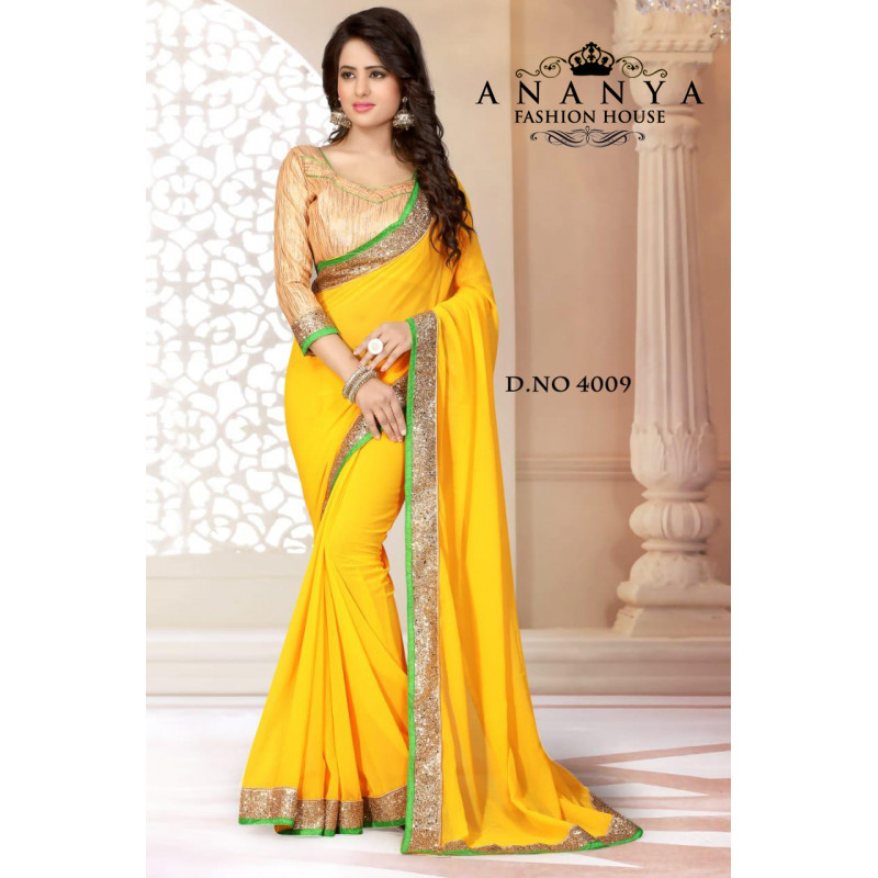 Enigmatic Green Georgette Saree with Gold Blouse
