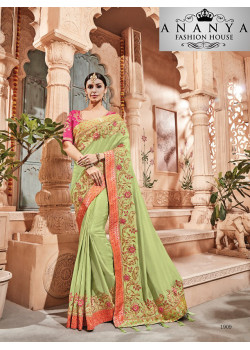 Enigmatic Green Georgette Saree with Pink Blouse
