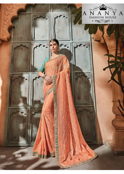 Melodic Orange Georgette Saree with Blue Blouse