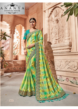 Flamboyant yellow Georgette Saree with Green Blouse