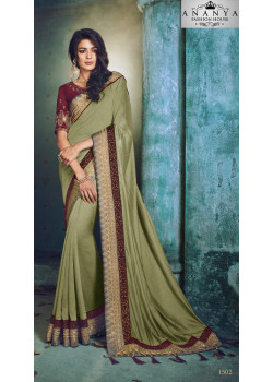 Adorable Green Georgette Saree with Maroon Blouse