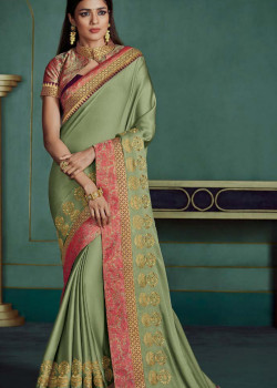Luscious Green Georgette Saree with Pink Blouse