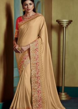Melodic Yellow Georgette Saree with Pink Blouse