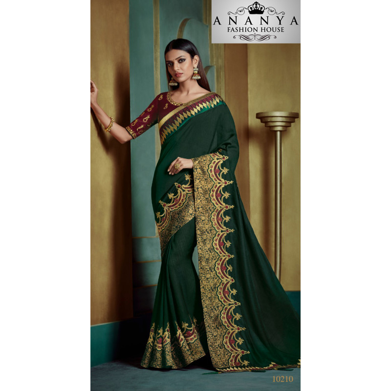 Exotic Dark Green Georgette Saree with Maroon Blouse