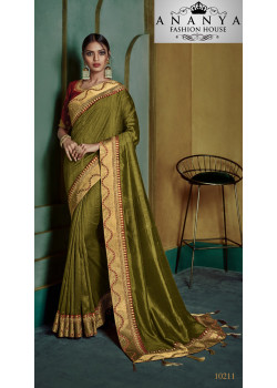 Magnificient Green Georgette Saree with Pink Blouse