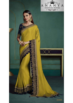 Trendy Yellow Georgette Saree with Dark Blue Blouse