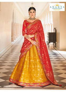 Dazzling Yellow color Banarasi Tissue Designer Lehenga