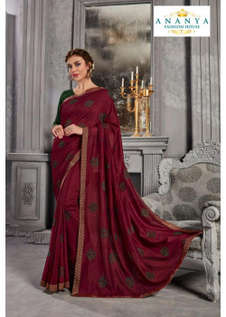 Adorable Wine Silk Saree with Bottle Green Blouse