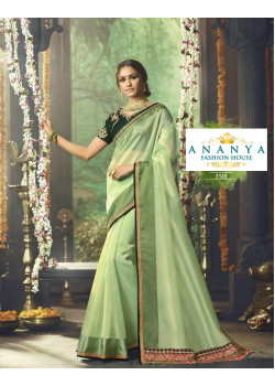 Plushy Pista Green Organza Saree with Bottle Green Blouse