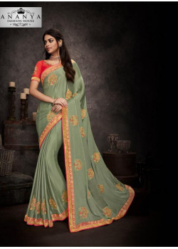 Magnificient Pastel Green Silk Saree with Red Blouse