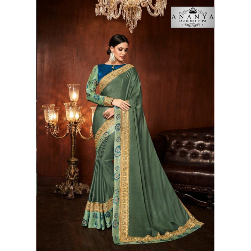 Enigmatic Pastel Green Silk Saree with Blue Blouse