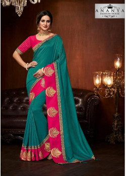 Gorgeous Turquiose Silk Saree with Magenta Blouse