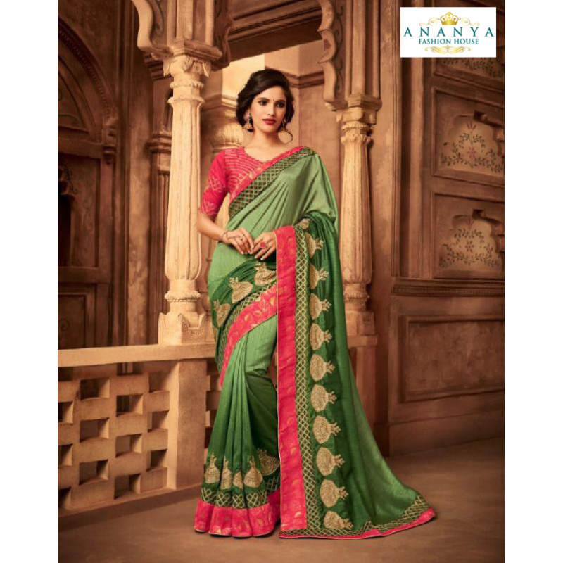 Magnificient Pista Green Silk Saree with Pink Blouse