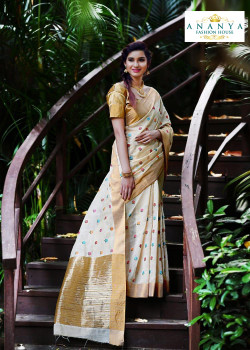 Flamboyant Off White Silk Saree with Gold Blouse