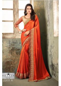 Charming Orange Silk Saree with Gold Blouse