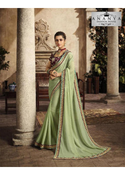 Enigmatic Pista Green Silk Saree with Purple Blouse