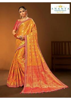 Classic Yellow- Orange Silk Saree with Magenta Blouse