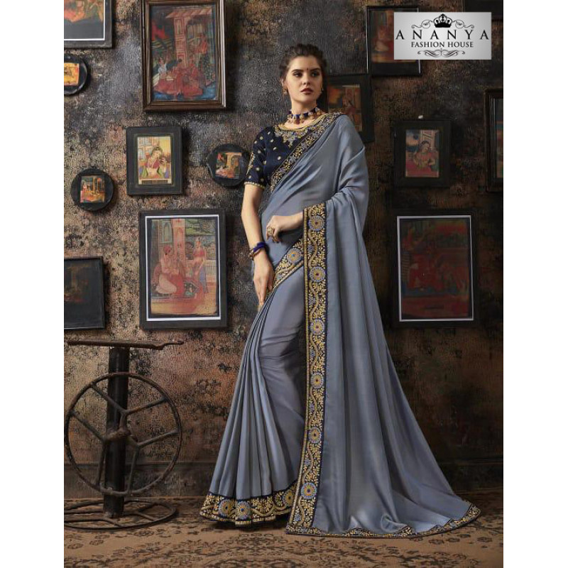 Magnificient Pastel Blue Georgette Silk Saree with Dark Grey Blouse