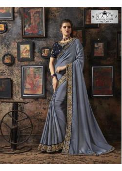 Magnificient Pastel Blue Georgette Silk Saree with Dark Grey Blouse