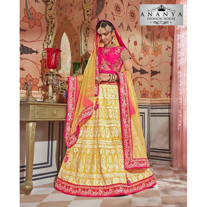 Enigmatic Yellow color Net Designer Lehenga