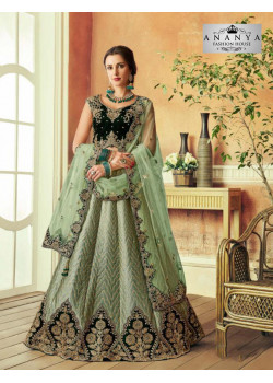 Melodic Light Pista Green color Silk Designer Lehenga