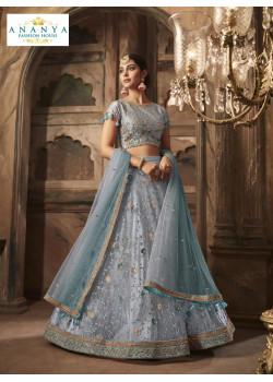 Luscious Pastel Blue color Net - Santoon Designer Lehenga