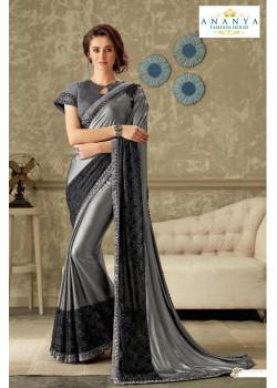 Adorable Silver Lycra Saree with Grey Blouse