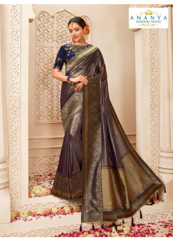 Magnificient Metallic Purple Banarasi Silk Saree with Dark Blue Blouse
