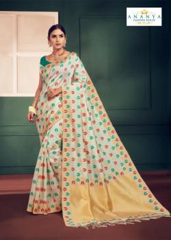 Flamboyant Whiite Silk Saree with Rama Green Blouse