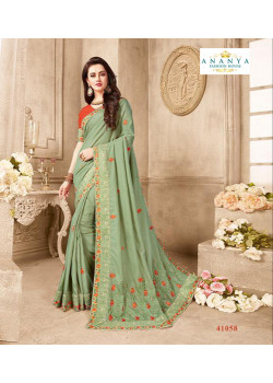 Enigmatic Pastel Green Silk Saree with Orange Blouse