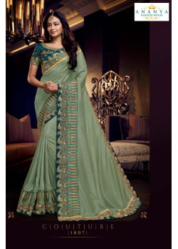 Adorable Pastel Green Silk Saree with Turquoise Blouse