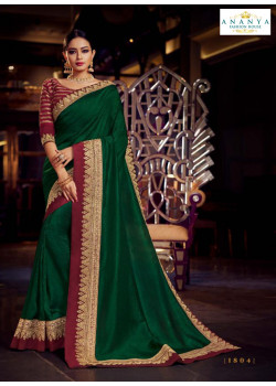 Enigmatic Bottle Green Silk Saree with Maroon Blouse