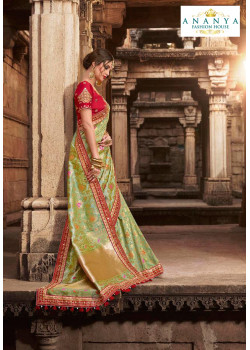 Exotic Pista Green Silk modal Saree with Red Blouse