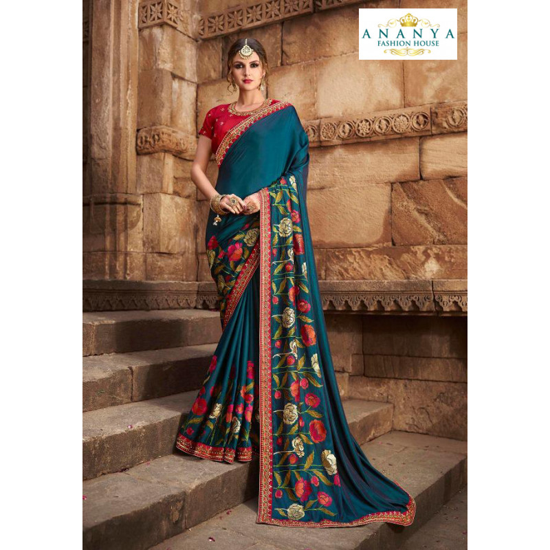Luscious Turquoise Silk modal Saree with Red Blouse