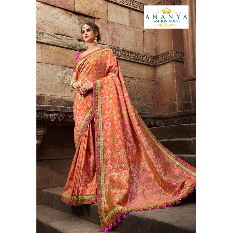 Magnificient Light Orange Silk modal Saree with Magenta Blouse